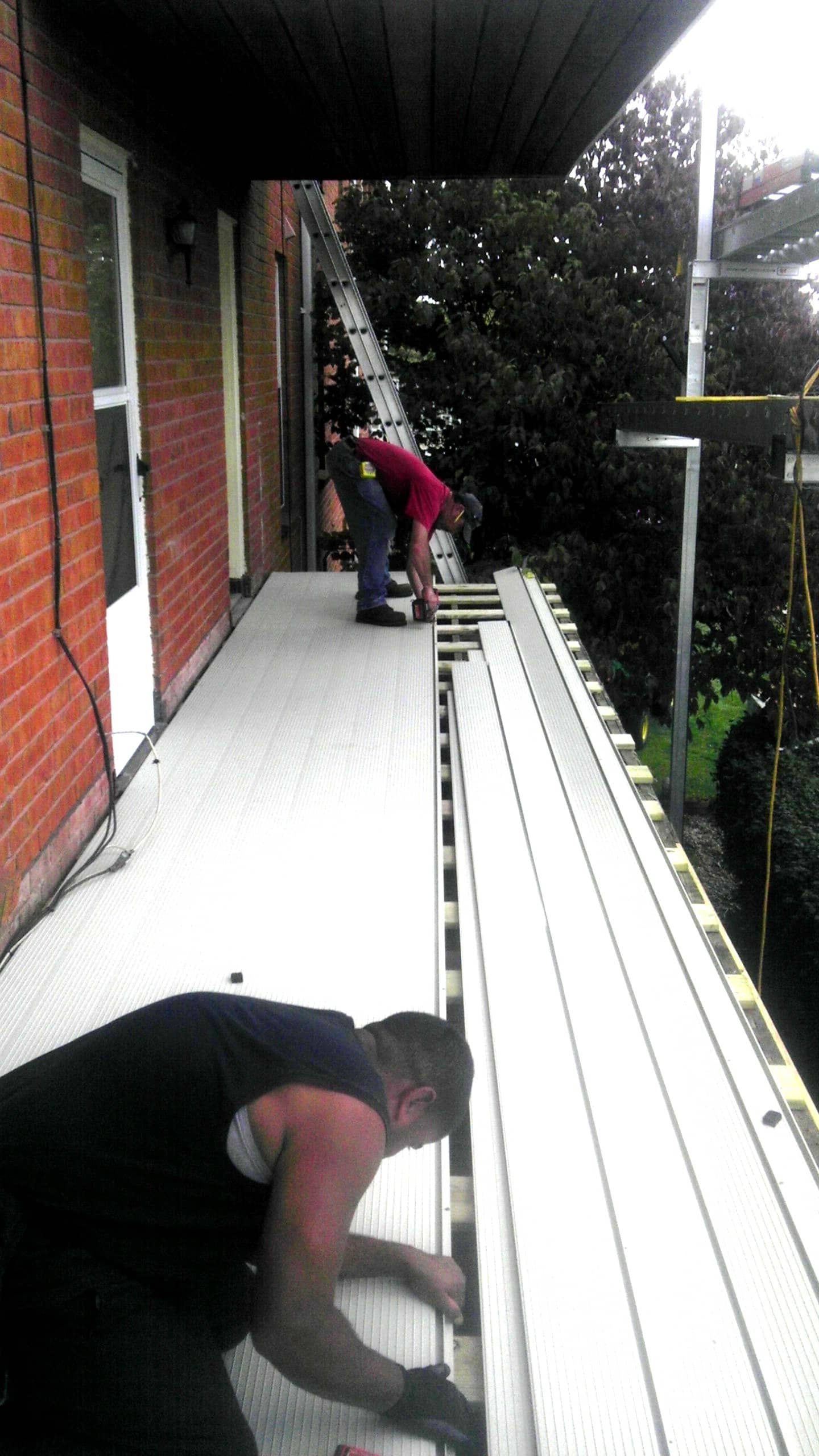 ariddek aluminum decking boards at Village Green Apartments by Wahoo Decks