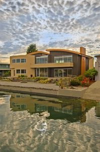 The Carkonen residence with Wahoo Fortis aluminum decking features two waterfront balconies.