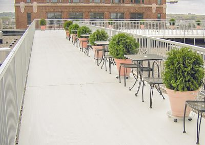 AridDek Waterproof Decking Rooftop With Chairs And City View