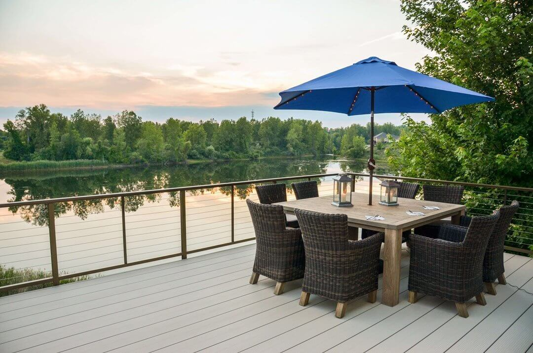 Fortis Aluminum Decking On Dock Beside Lake With Table And Chairs
