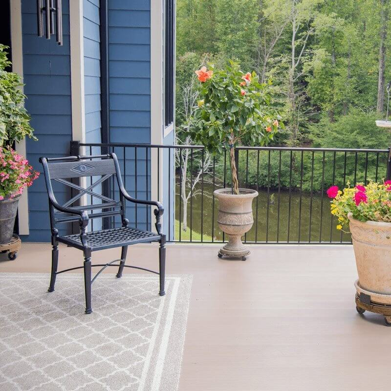 AridDek Waterproof Deck System Beside A Lake With Flower Pots and Deck Chair